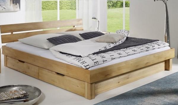 Bett mit Bettkästen 'Lewis' 140x200cm Kernbuche massiv Kopfteil geteilt